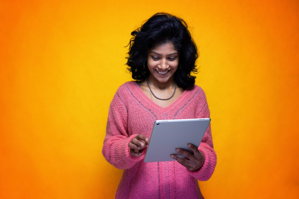 Woman her touchscreen tablet, touching the display with her hand