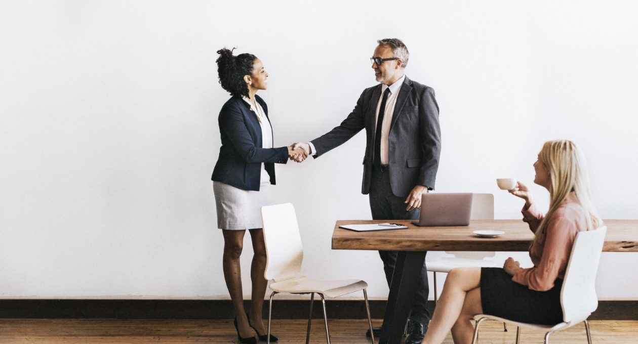 Woman shaking hands with a businessman